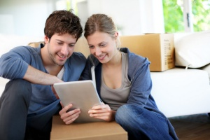 couple packing on moving day