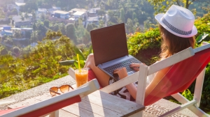 Digital Nomad with Laptop Overlooking Scenery