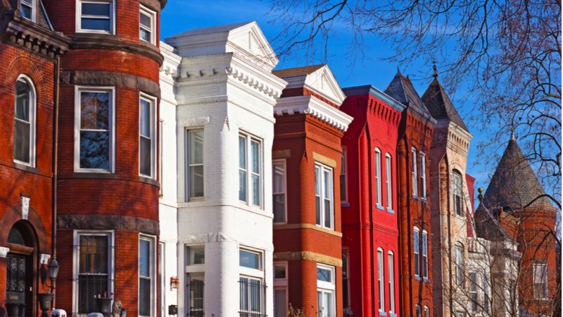 A row of red and white townhouses on a sunny day in Mount Vernon Square, D.C.