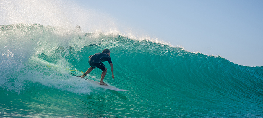 Surfing riding wave in Hawaii