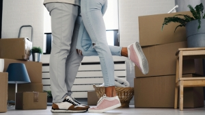 Couple Moving into Home with Boxes