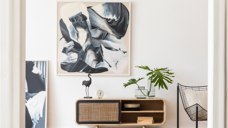abstract art hanging on a wall