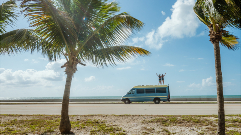 couple RV-ing in a tropical setting