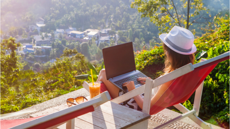 digital nomad girl working outdoors